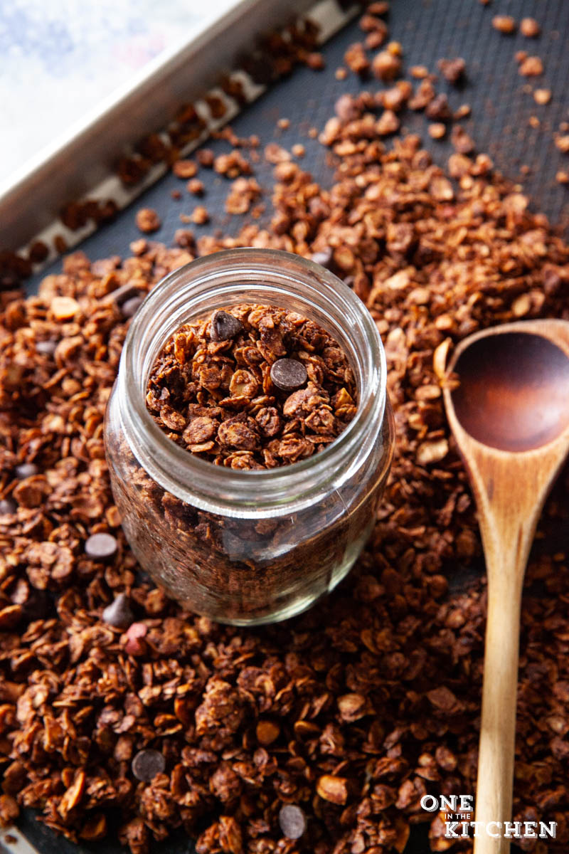 Peanut Butter Chocolate Granola in the pan and in a glass jar
